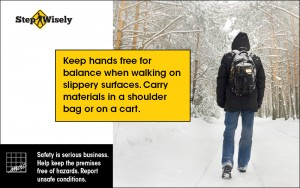 Man wearing backpack walking in the snow. Keep hands free for balance.