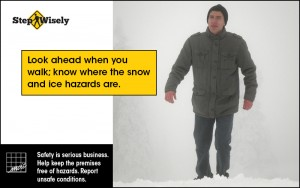 Look ahead when walk; know where the snow and ice hazards are. Image of man walking in snow with his head up.