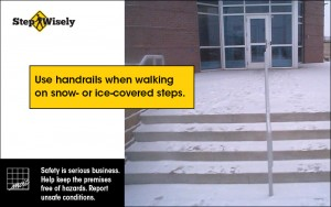 Image of snow-covered stairs with a handrail. Use handrails when walking on snow- or ice-covered steps.