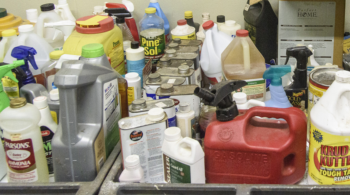 Shelf filled with common household cleaners and chemicals