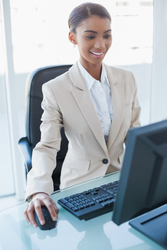 Businesswoman working on her computer in bright office