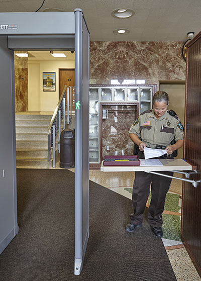 Deputy sheriff on duty at security check point into courthouse