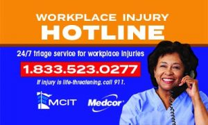 Workplace Injury Hotline magnet image showing nurse on phone smiling at camera