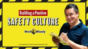 "Middle-aged man holds a clipboard and pen against bright yellow background with text ""Building a Positive Safety Culture"""