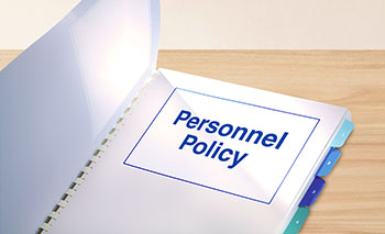 Personnel policy opened on table